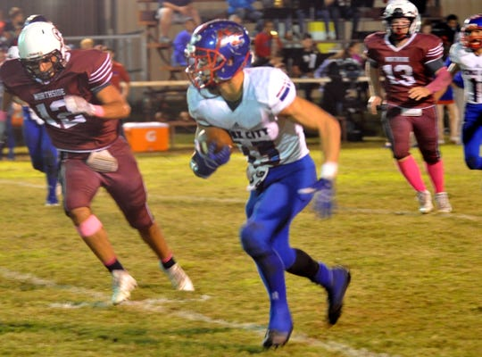Knox City's Wesson Ham works to outrun Northside's Devon Matthews in the first quarter Friday night.