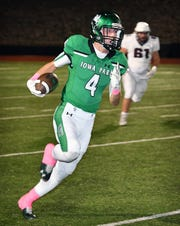 Iowa Park ball carrier Cirby Coheley (4) picks up good yardage during Friday night's game against Vernon in Iowa Park.