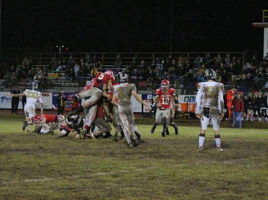 Jett Johnson leaps onto player pile
