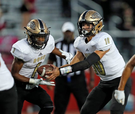 Rider's Jacob Rodriguez (10) hands the ball off to Samuel Manuel (1) during the game against Lubbock-Cooper, Friday, Oct. 19, 2018, in Woodrow, Texas. [Brad Tollefson/A-J Media]