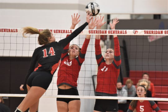 Sheridan's Emma Conrad (left) and Rachel Cooke try to block a Logan Elm hitter's shot in Saturday's Division II sectional final. The Generals won in three sets.