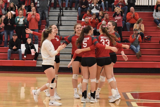 The Sheridan volleyball team celebrates its second straight Division II sectional title after beating Logan Elm in three sets, 25-8, 25-7, 25-8, on Saturday.