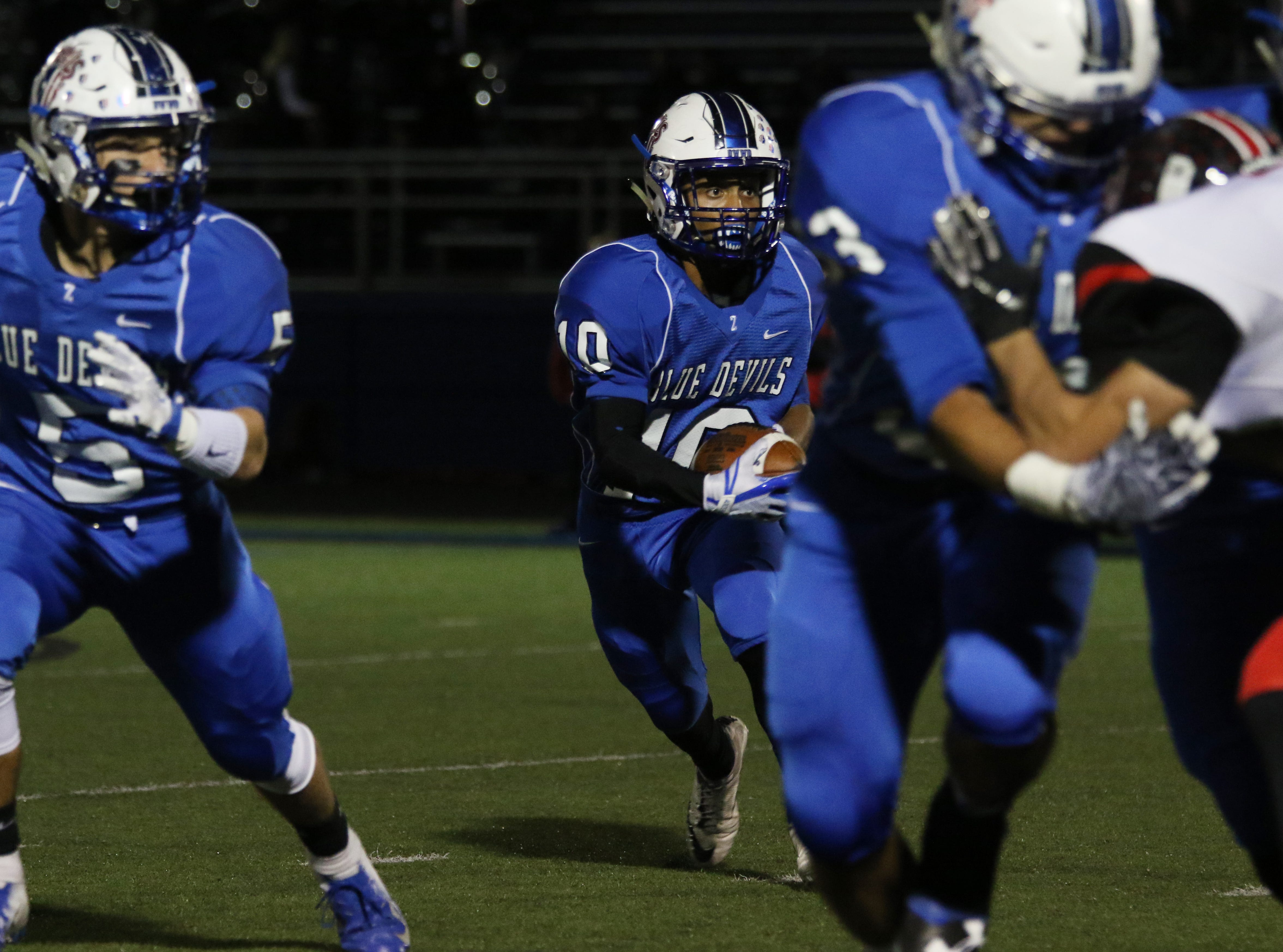 Zanesville's Jeremiah Norman carries the ball against New Philadelphia.