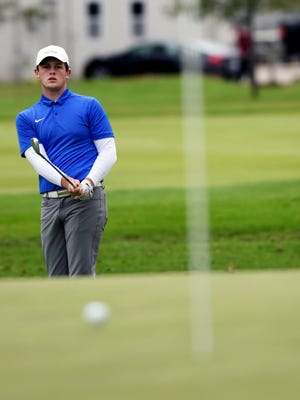 Maysville's Luke Morrow watches as his chip rolls near the hole during the Division I state golf tournament on Friday at Ohio State's Scarlet Course. Morrow is tied for 26th after an 83.