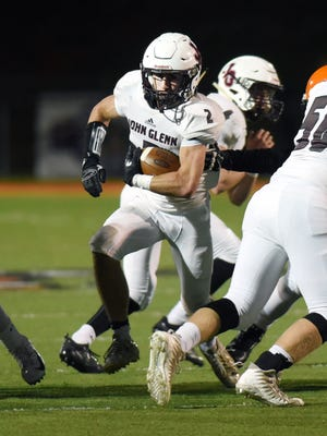 Brady Emerson runs through a hole during John Glenn's 34-0 win last season against New Lexington at Jim Rockwell Stadium. Emerson is among several key returners for the Muskies this season in their quest to return to the playoffs.