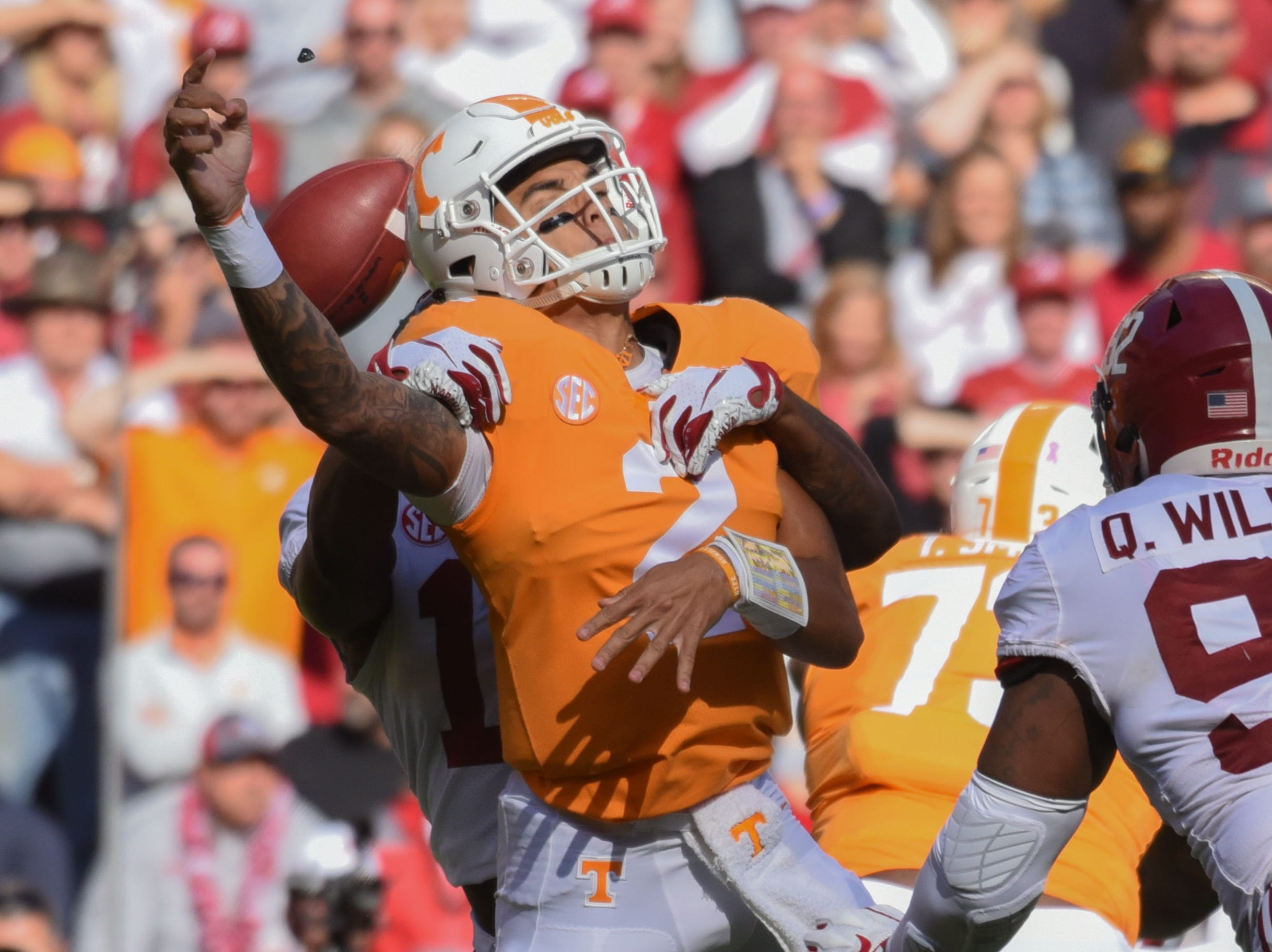 Alabama Crimson Tide defensive back Xavier McKinney (15) sacks Tennessee Volunteers quarterback Jarrett Guarantano (2) during the first half at Neyland Stadium.