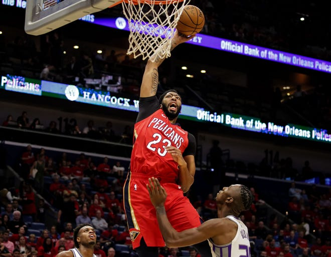 Oct. 19: Pelicans forward Anthony Davis (23) throws down a monster one-handed slam over Kings defender Harry Giles (20).