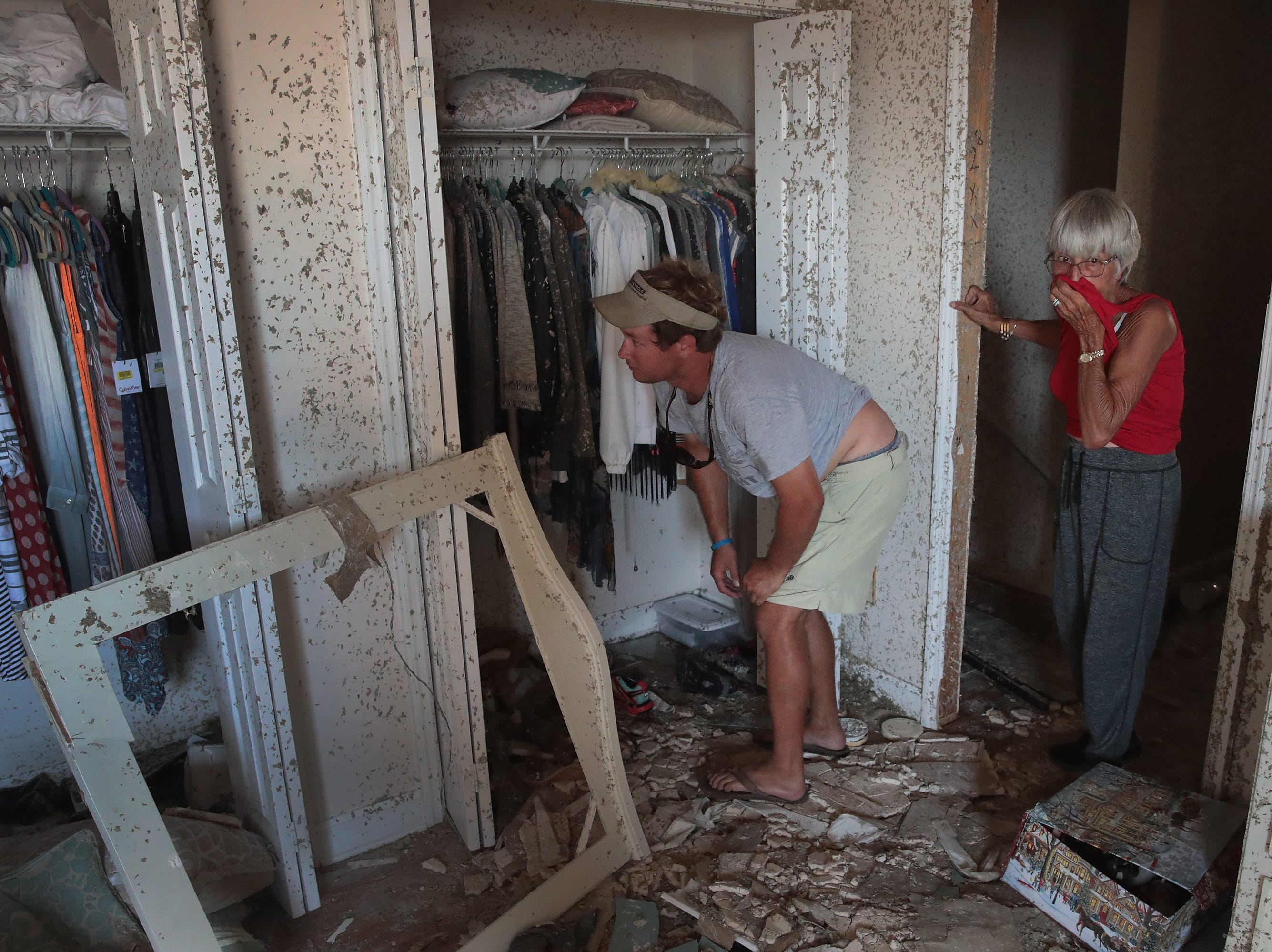 John McClenny helps LeClaire Bryan, mother of country music artist Luke Bryan, recover items from her home after it was severely damaged by Hurricane Michael on Oct. 19, 2018 in Mexico Beach, Fla.