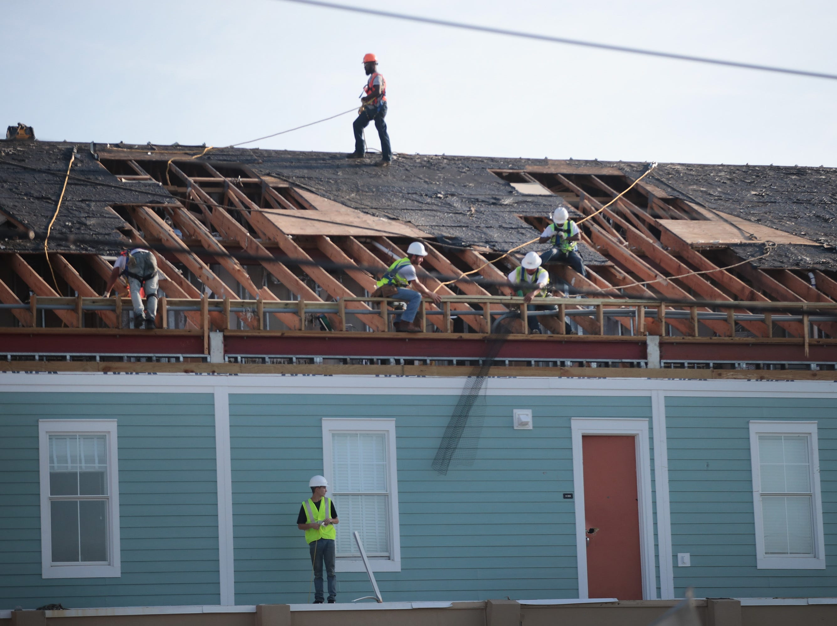 Contract workers begin repairing damaged buildings and removing debris following Hurricane Michael on Oct. 19, 2018 in Mexico Beach, Fla.
