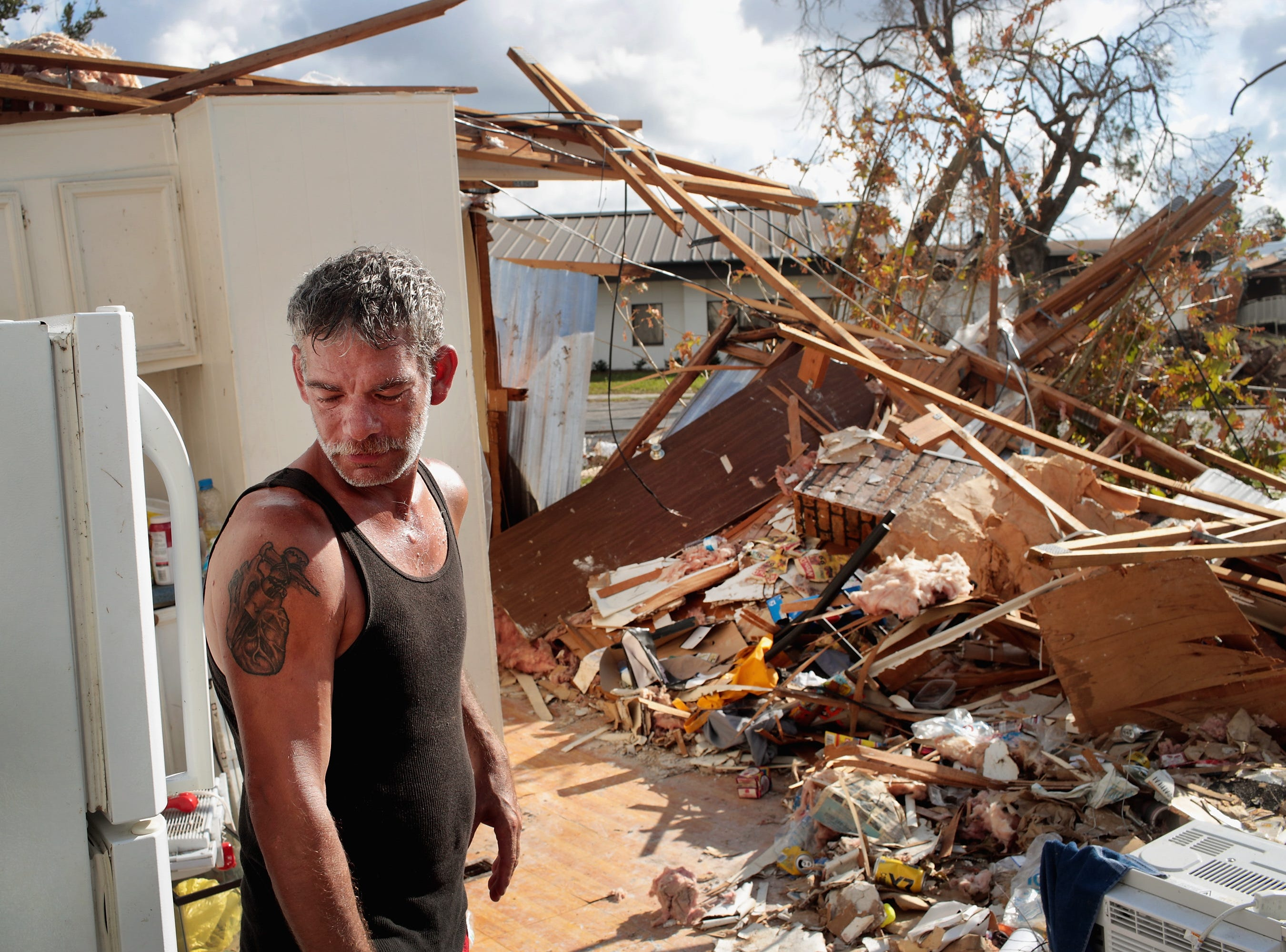 Chet Bundy stands in the kitchen of the trailer home he was in when Hurricane Michael passed through on Oct. 20, 2018 in Panama City, Fla. He survived the storm crouching in the bathroom with his partner and pets as the trailer was ripped apart.