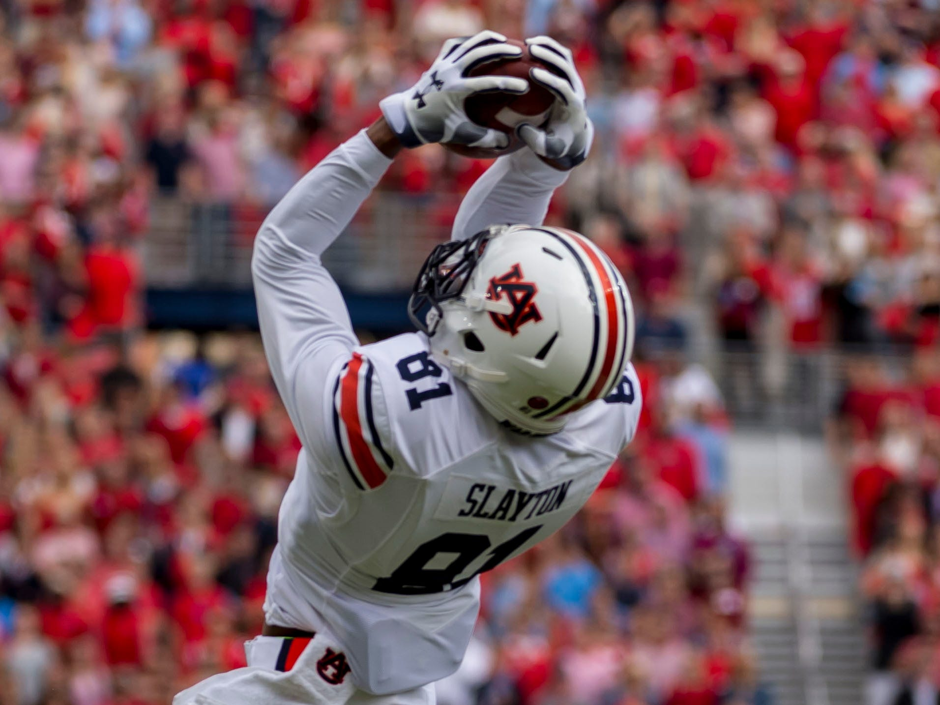 Auburn Tigers wide receiver Darius Slayton (81) makes a leaping grab in the red zone against the Mississippi Rebels during the first half at Vaught-Hemingway Stadium.