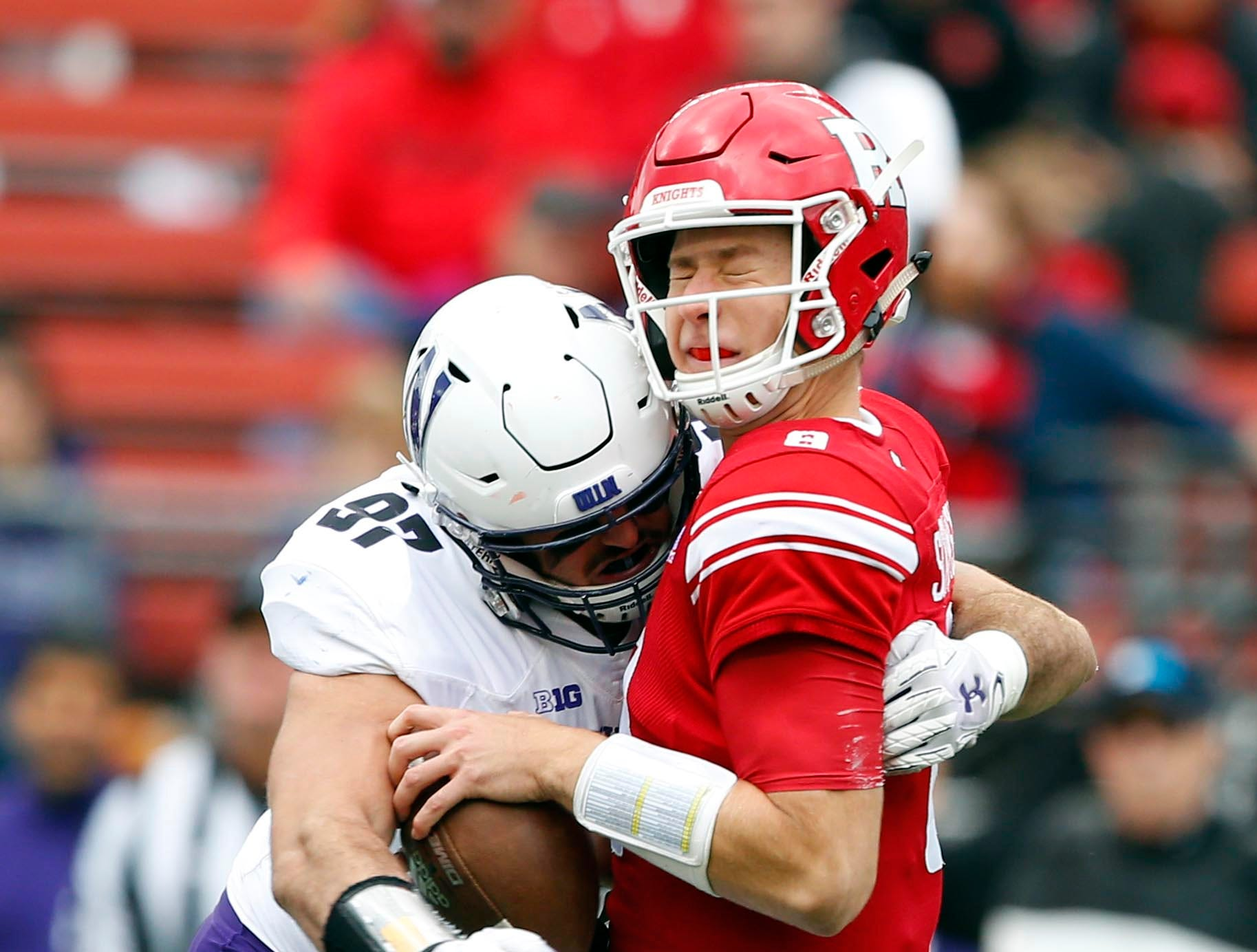 Rutgers Scarlet Knights quarterback Artur Sitkowski (8) is sacked by Northwestern Wildcats defensive lineman Joe Gaziano (97) during the first half at High Point Solutions Stadium.