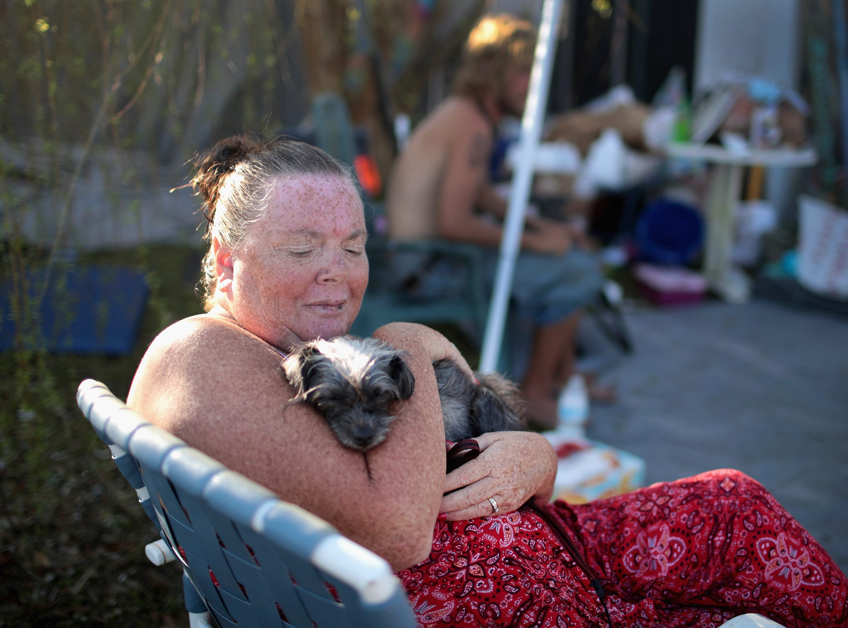 Tracey Lachance sits outside of her home which was severely damaged by Hurricane Michael on Oct. 20, 2018 in Panama City, Fla. Much of Panama City remains without electricity or running water since Hurricane Michael slammed into the Florida Panhandle on October 10.