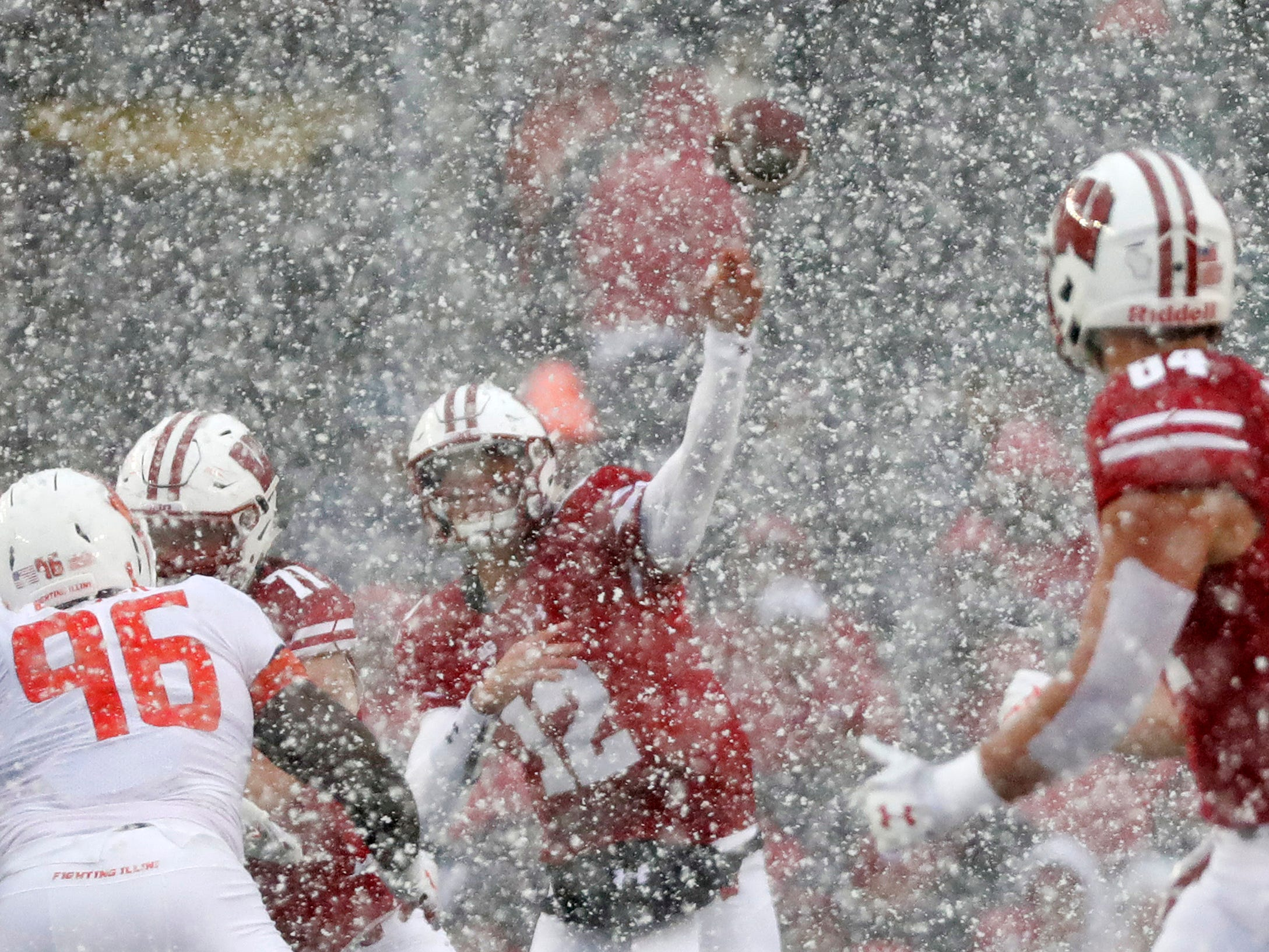 Wisconsin Badgers quarterback Alex Hornibrook fires a first-half pass during a brief but intense snow storm at Camp Randall Stadium.