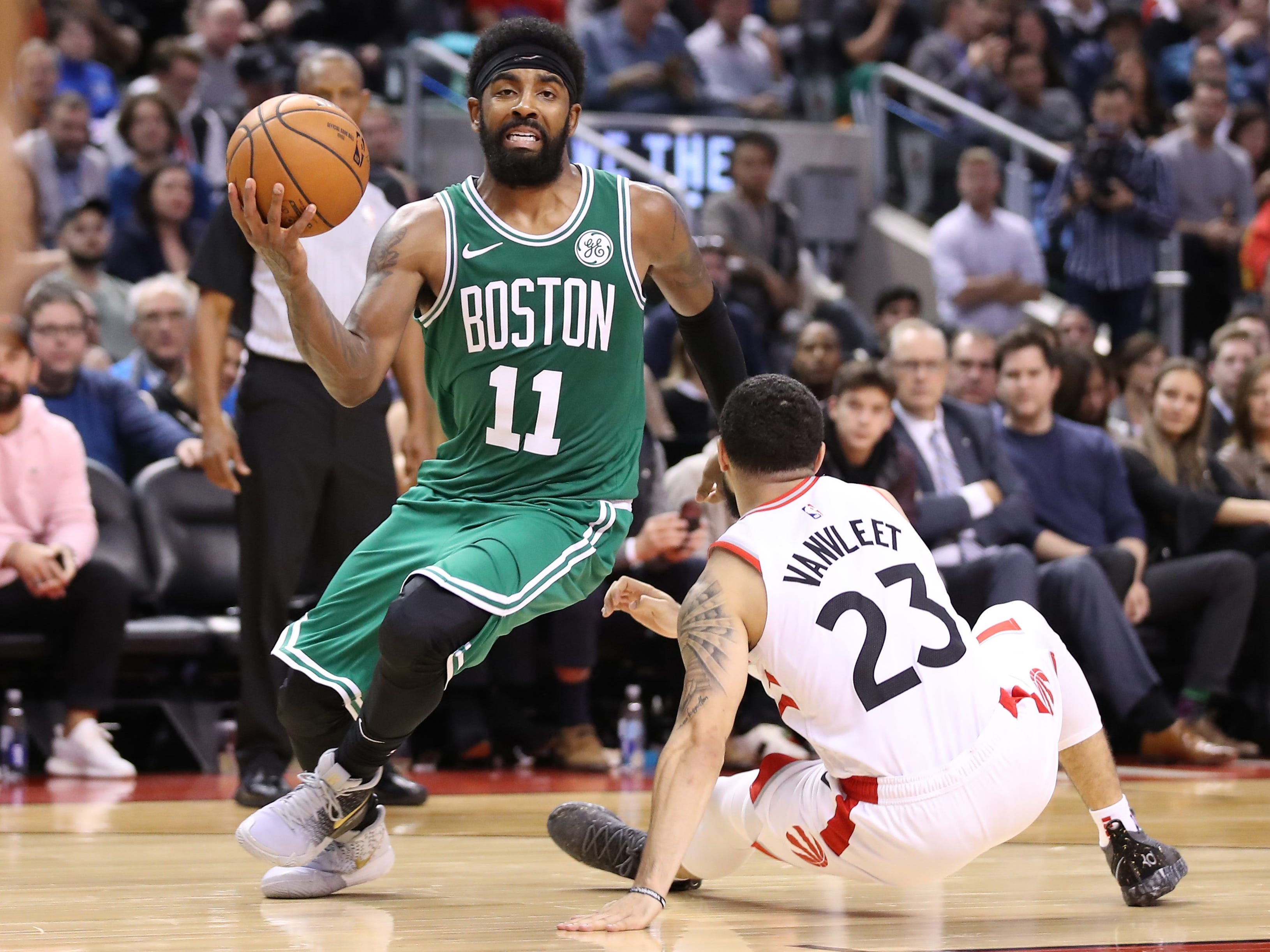 Oct. 19: Celtics guard Kyrie Irving (11) shakes off Raptors defender Fred VanVleet (23) with a crossover and drives to the bucket.