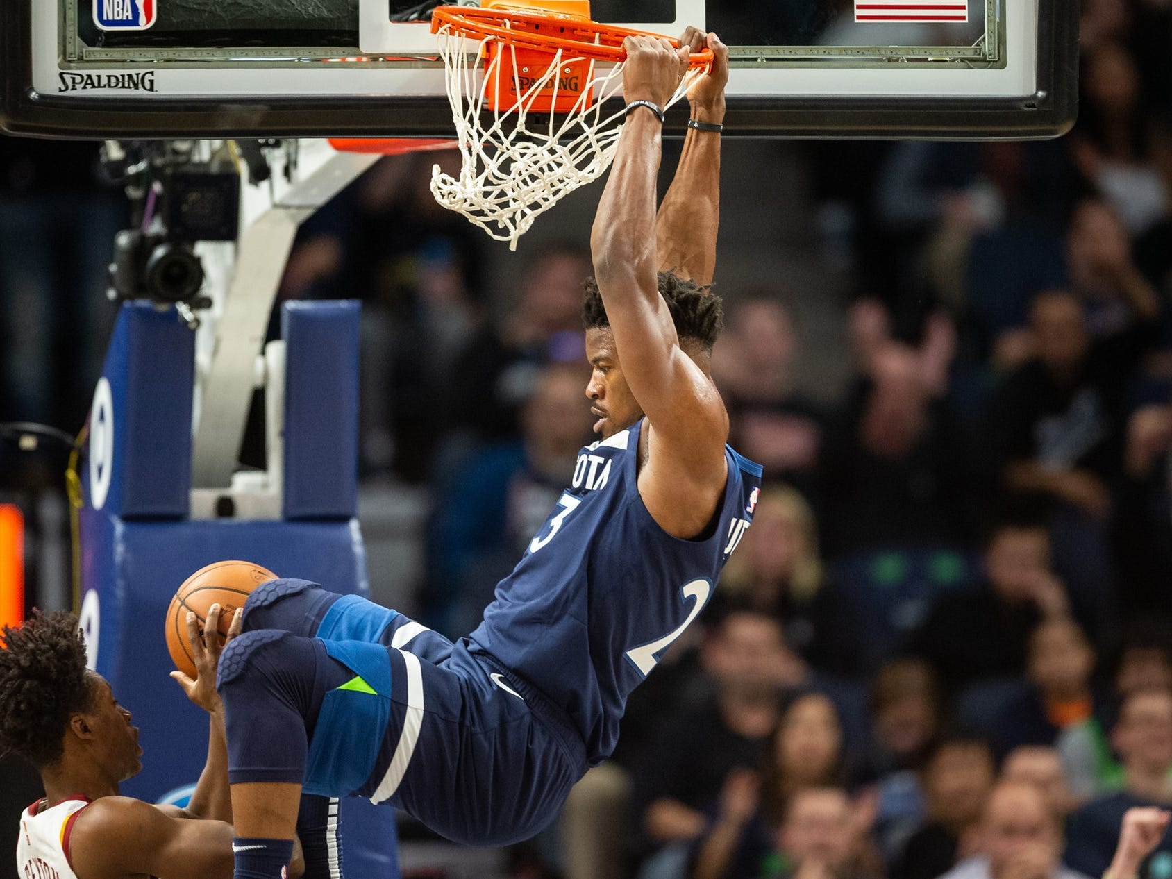 Oct. 19: Timberwolves forward Jimmy Butler throws down a two-handed flush against the Cavaliers.