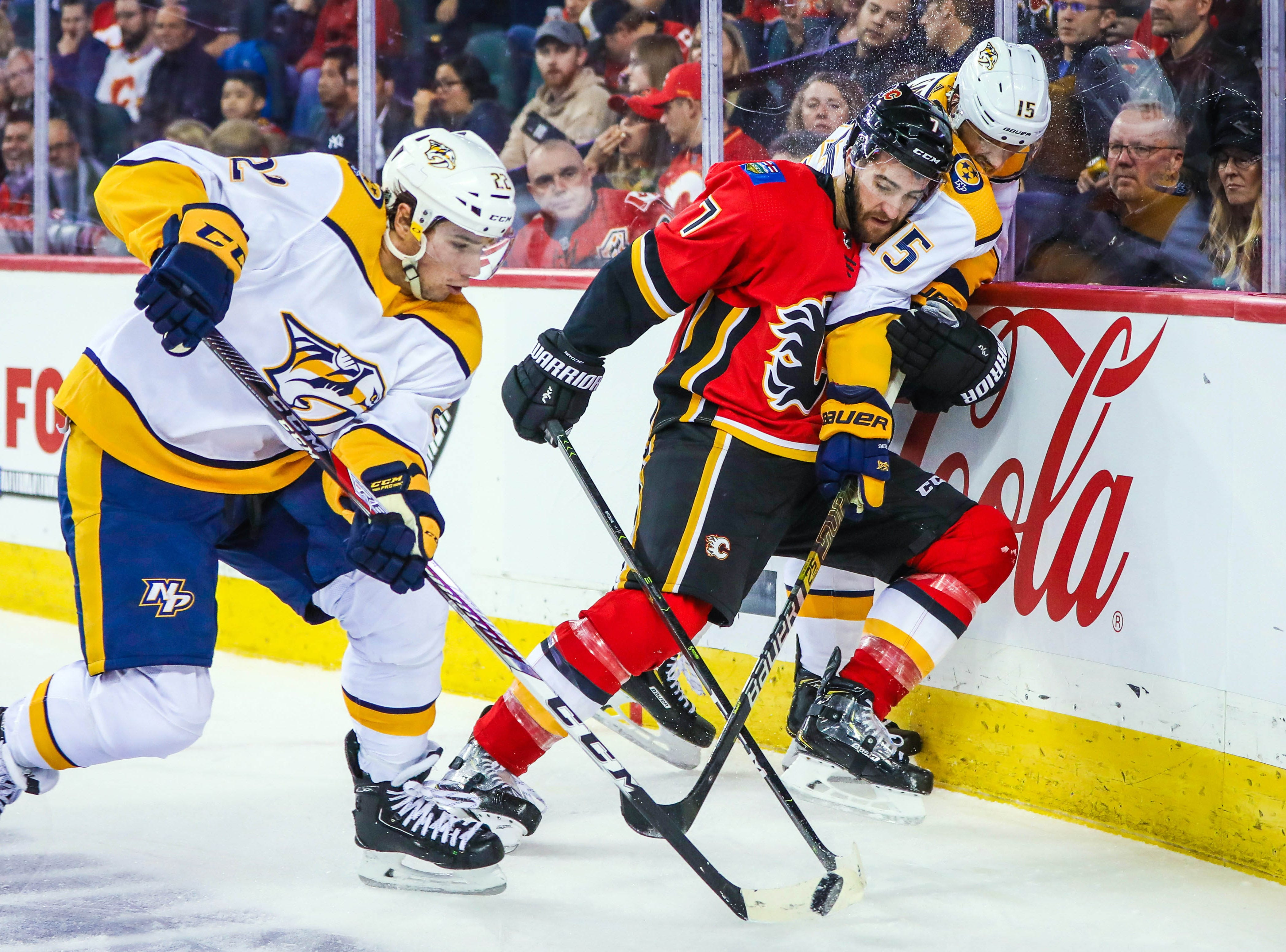 Oct. 19: Calgary Flames defenseman TJ Brodie (7) and Nashville Predators right wing Craig Smith (15) battle for the puck during the second period at Scotiabank Saddledome.