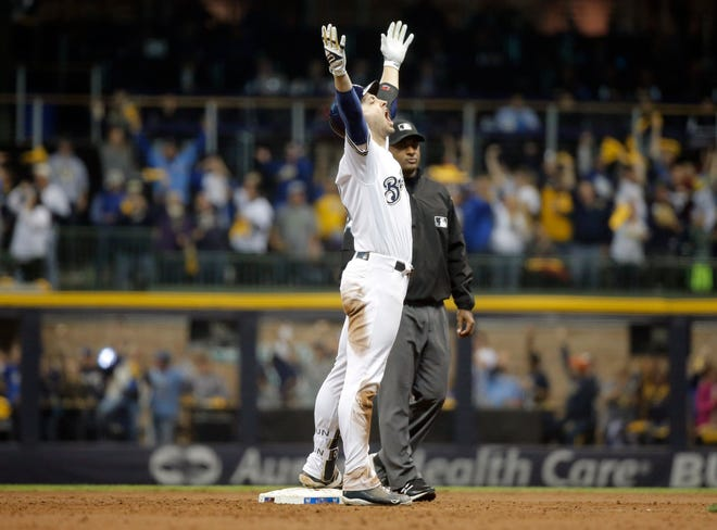 Ryan Braun celebrates after hitting an RBI double during the second inning in NLCS Game 6 at Miller Park.