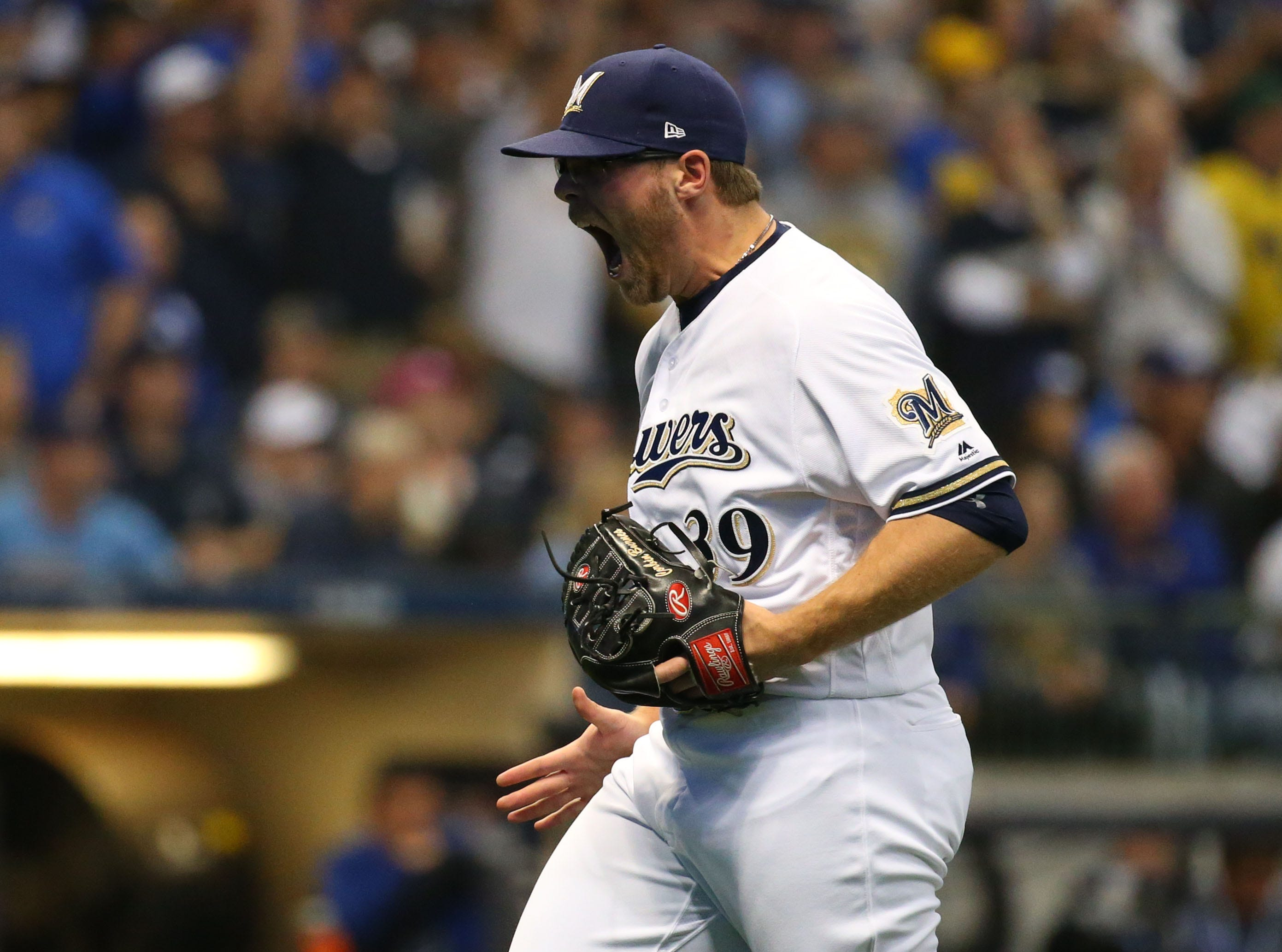 NLCS Game 6: Brewers pitcher Corbin Burnes reacts after retiring the Dodgers in the eighth.