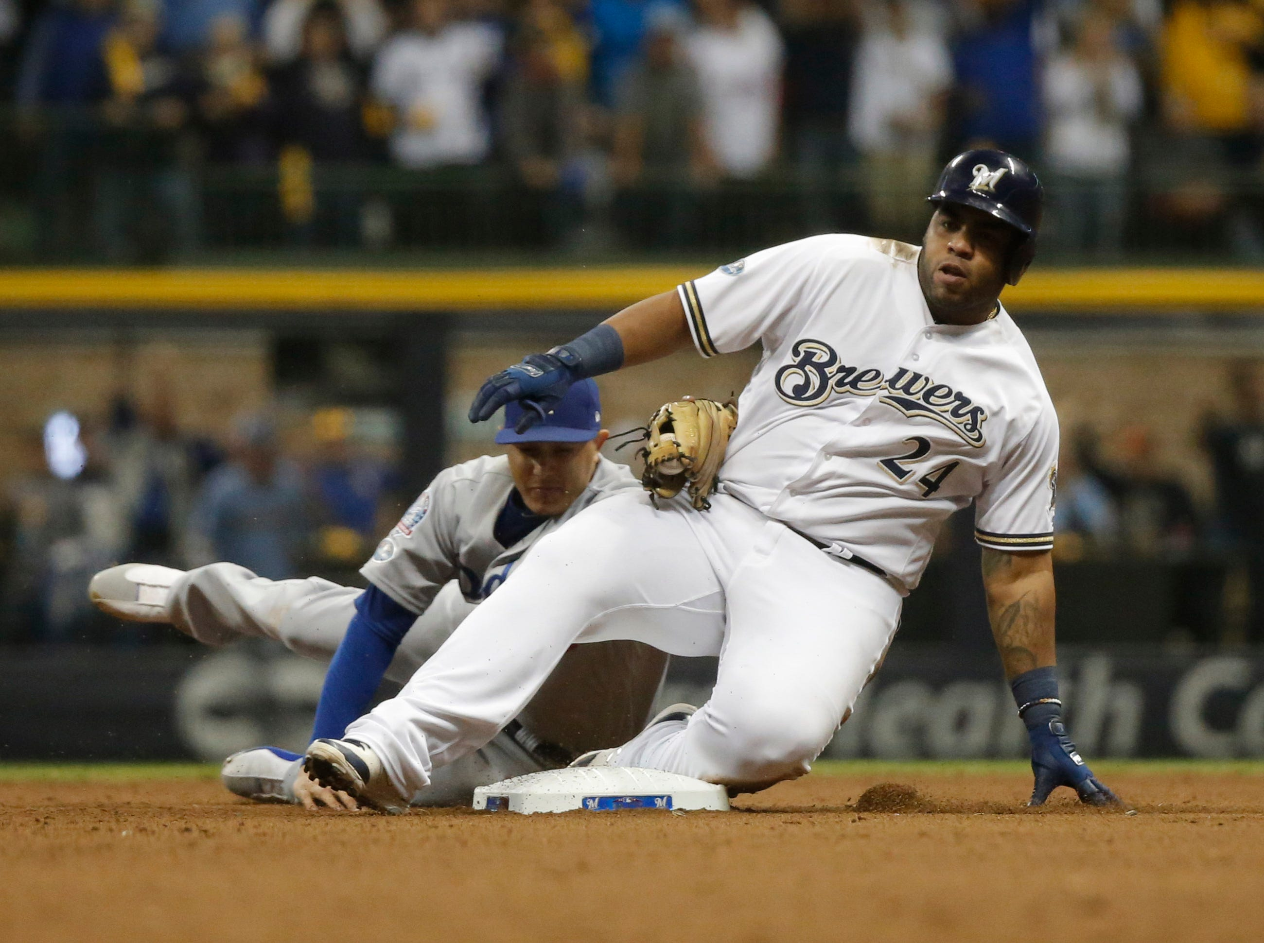 NLDS Game 6: Jesus Aguilar slides into second for a double in the seventh inning.