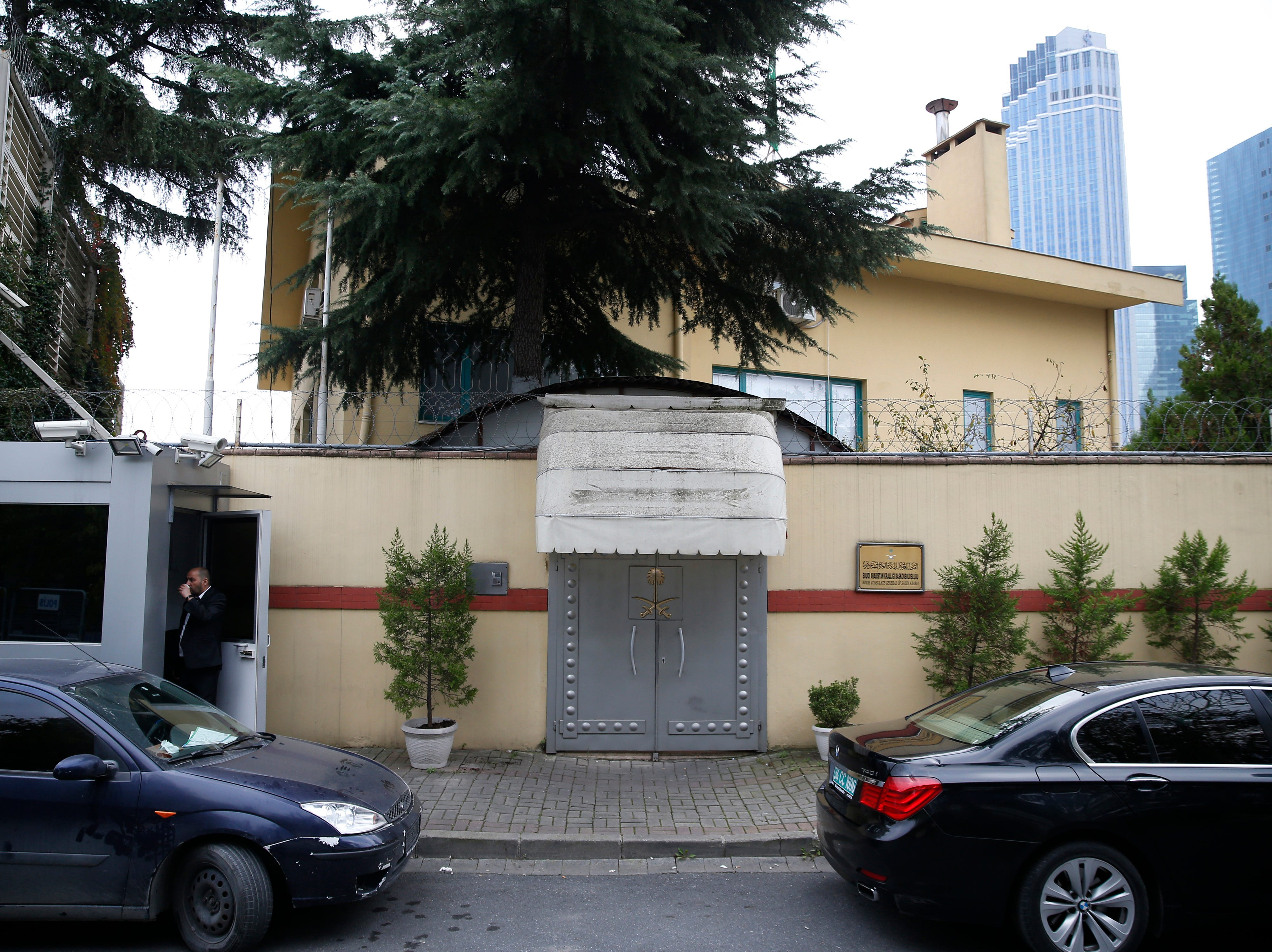 """A security guard stands outside Saudi Arabia's consulate in Istanbul, Saturday, Oct. 20, 2018. Saudi Arabia claims Saudi journalist Jamal Khashoggi died in a """"fistfight"""" in consulate, finally admitting that the writer had been slain at its diplomatic post."""