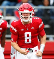 Rutgers Scarlet Knights quarterback Artur Sitkowski (8) shows his emotions after a fist-half touchdown against Northwestern.