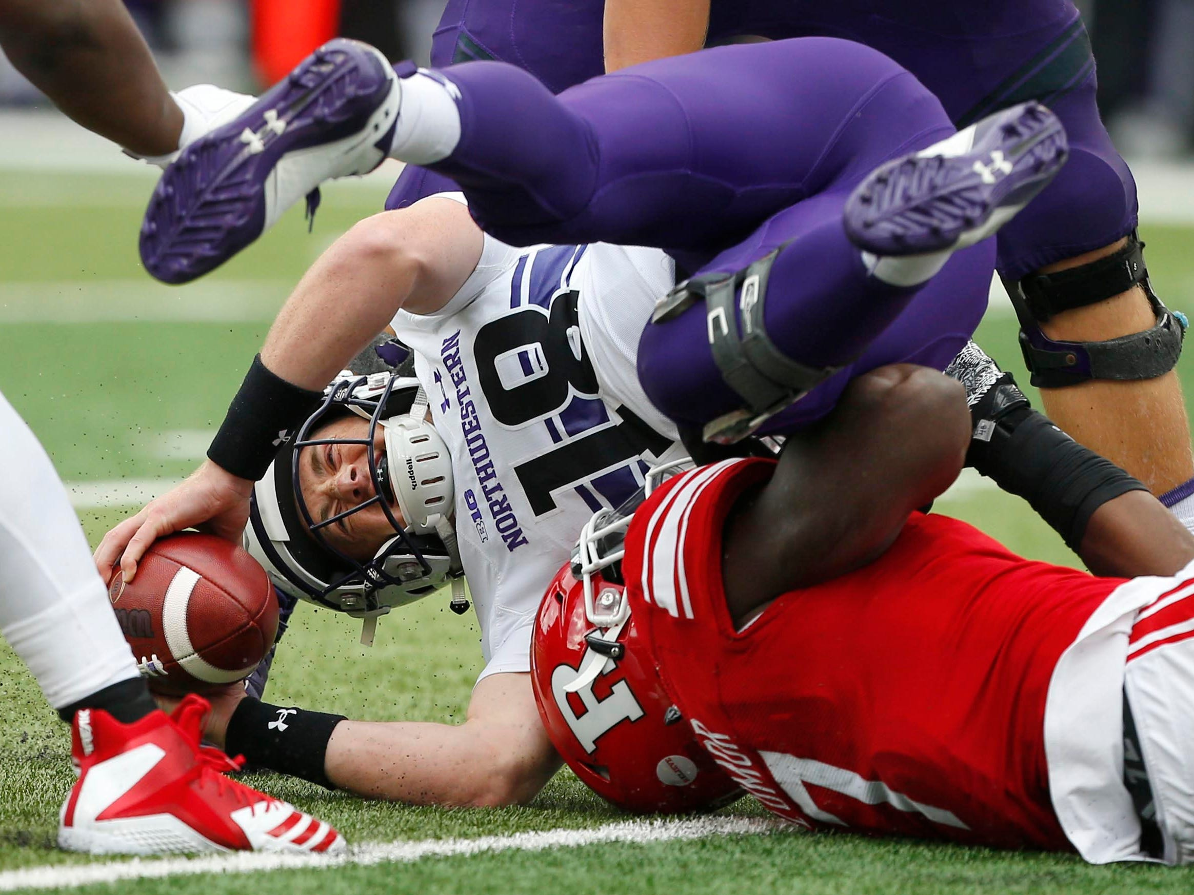 Rutgers Scarlet Knights defensive lineman Elorm Lumor sacks Northwestern Wildcats quarterback Clayton Thorson in the first half.