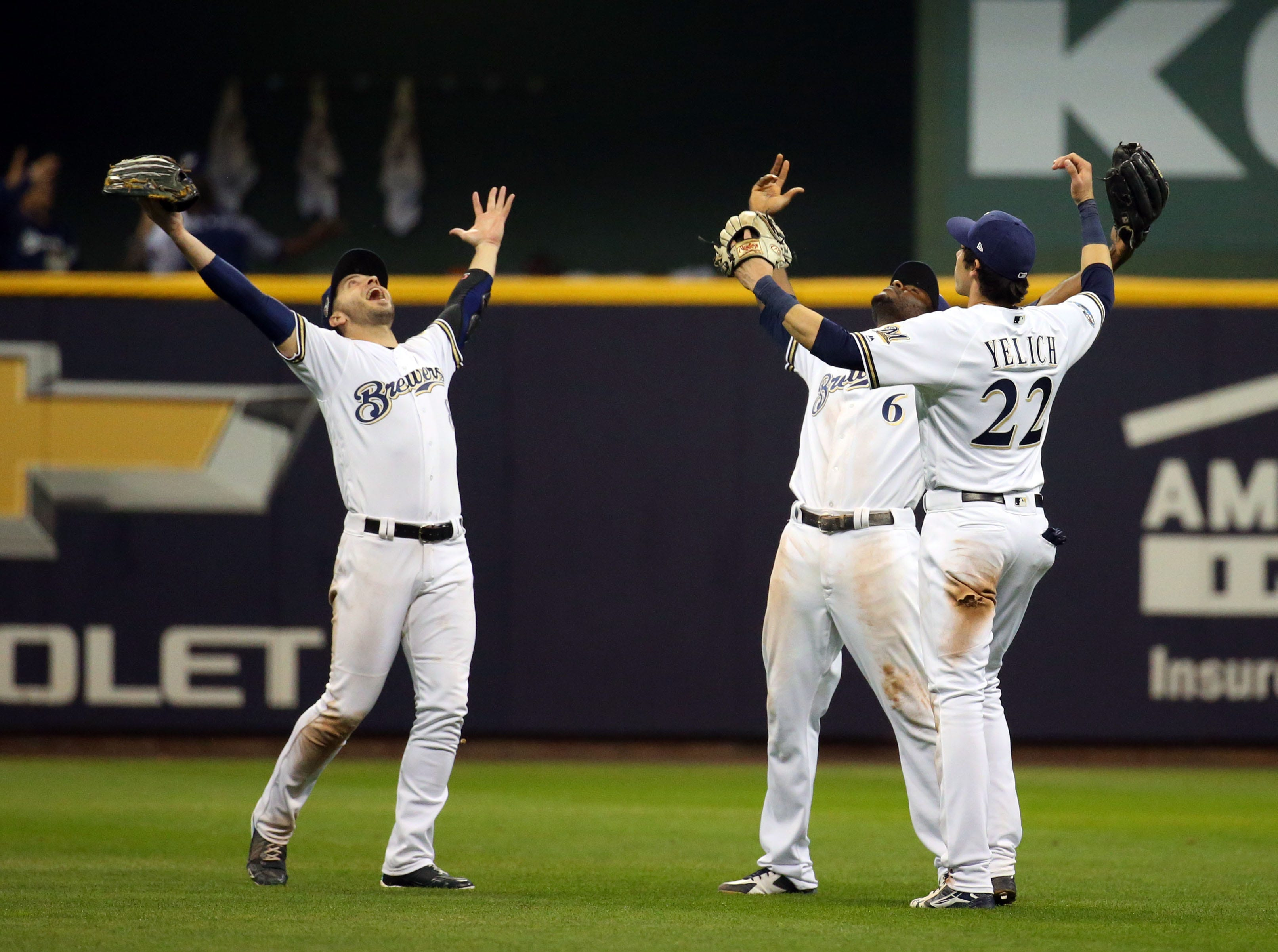 NLCS Game 6: Brewers outfielder Ryan Braun, Lorenzo Cain and Christian Yelich celebrate the win.