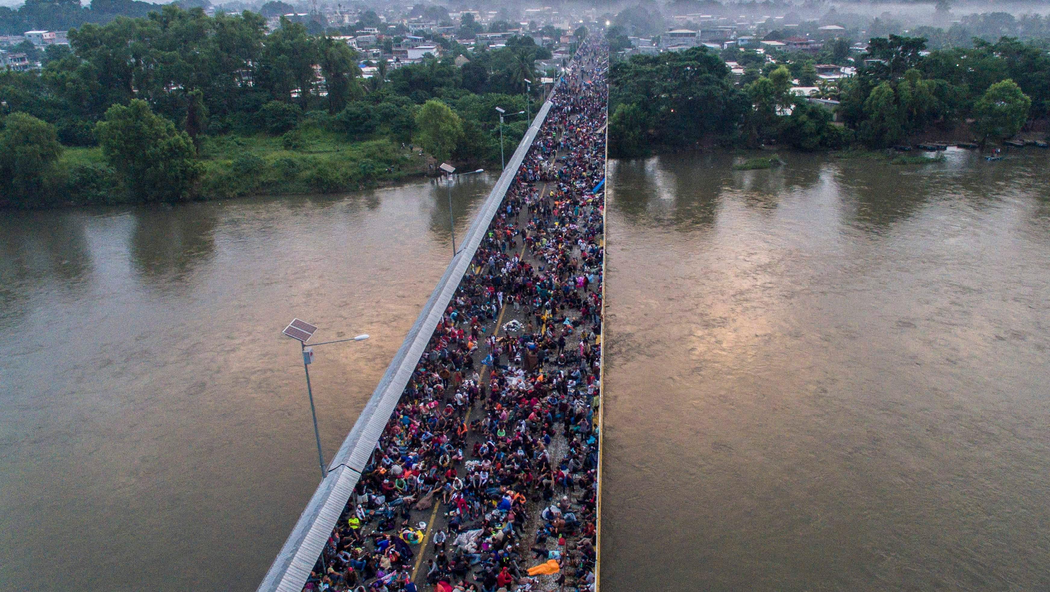 Aerial view of a Honduran migrant caravan heading to the US, on the Guatemala-Mexico international border bridge in Ciudad Hidalgo, Chiapas state, Mexico, on Oct. 20, 2018.