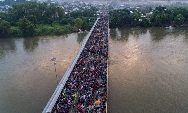 Aerial view of a migrant caravan heading to the U.S., on the Guatemala-Mexico international border bridge in Ciudad Hidalgo, Chiapas state, Mexico, on Oct. 20, 2018.