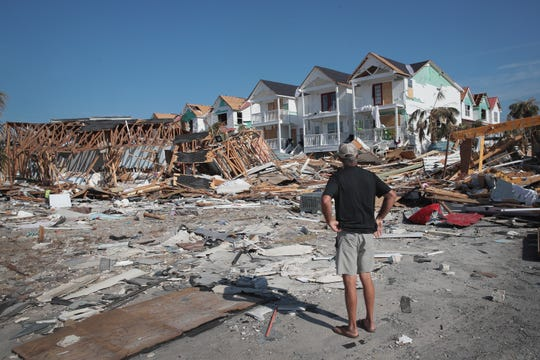James Whiddon looks over damage caused by Hurricane Michael on Oct. 19, 2018 in Mexico Beach, Fla.