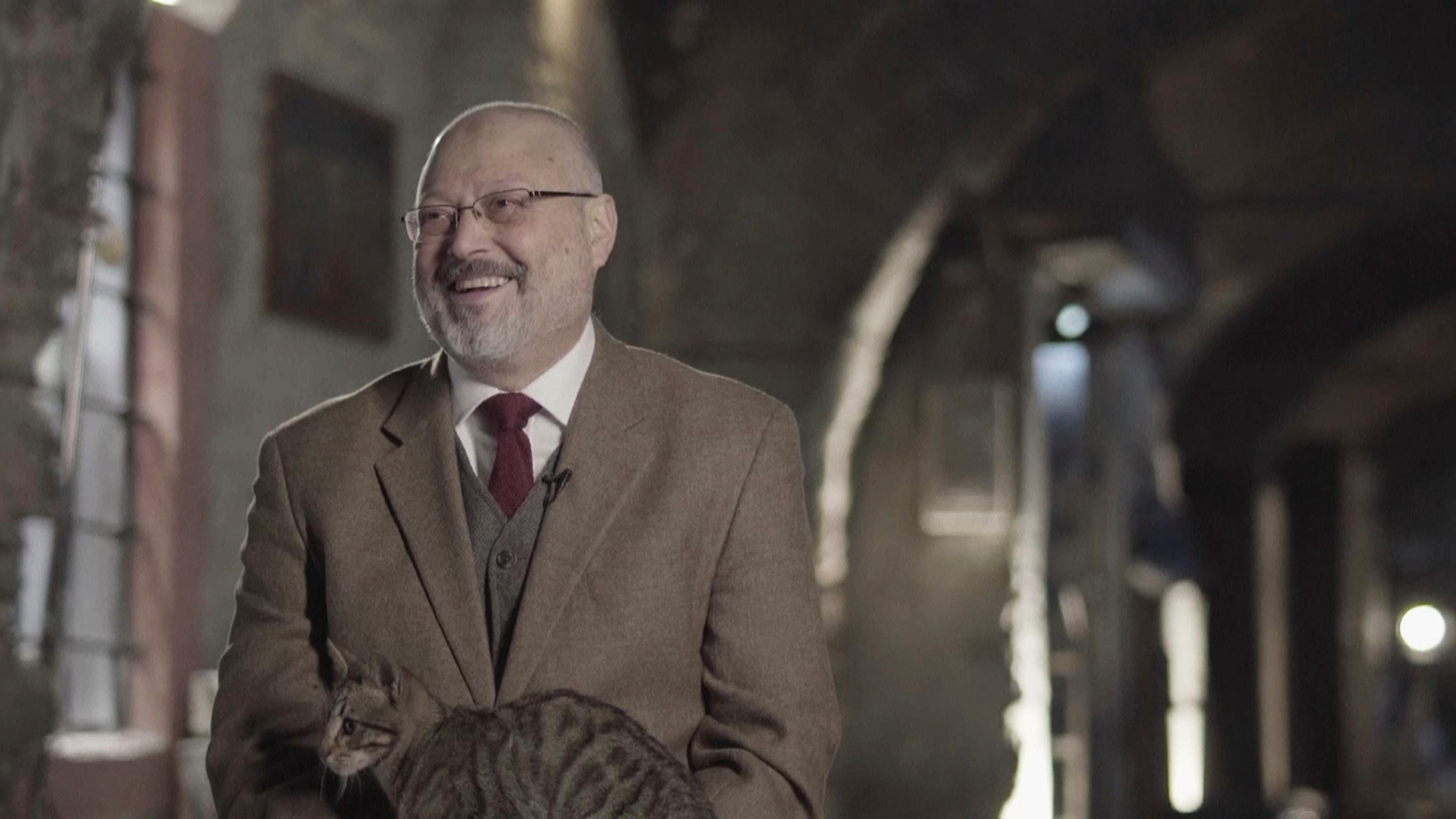 """In this image made from a March 2018 video provided by Metafora Production, Jamal Khashoggi reacts as a cat jumped on his lap, while speaking in an interview at an undisclosed location. Eighteen days after Khashoggi disappeared, Saudi Arabia acknowledged early Saturday, Oct. 20, 2018, that the 59-year-old writer has died in what it said was a """"fistfight"""" inside the Saudi consulate in Istanbul."""