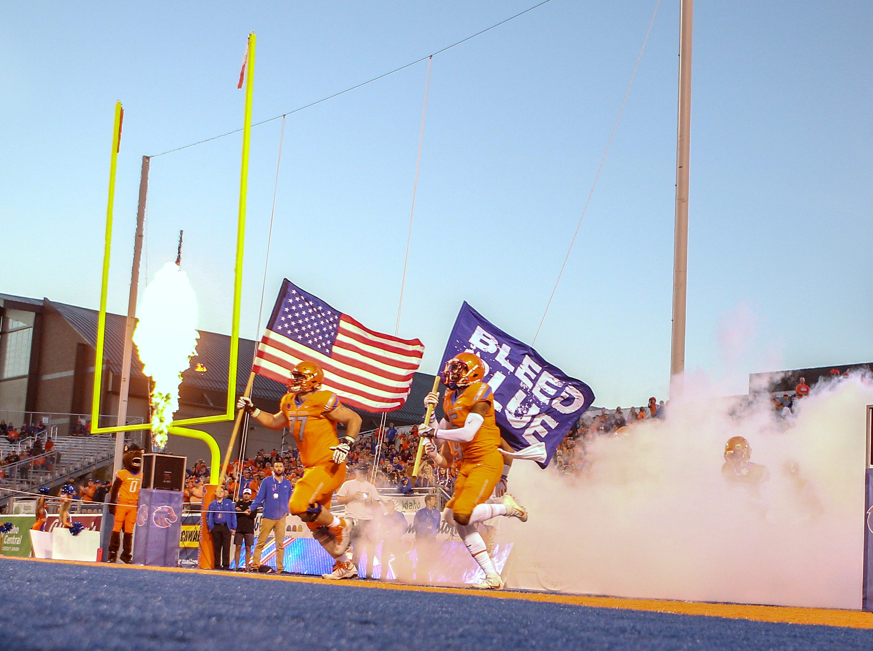 The Boise State Broncos take the field prior to a game against the Colorado State Rams at Albertsons Stadium.