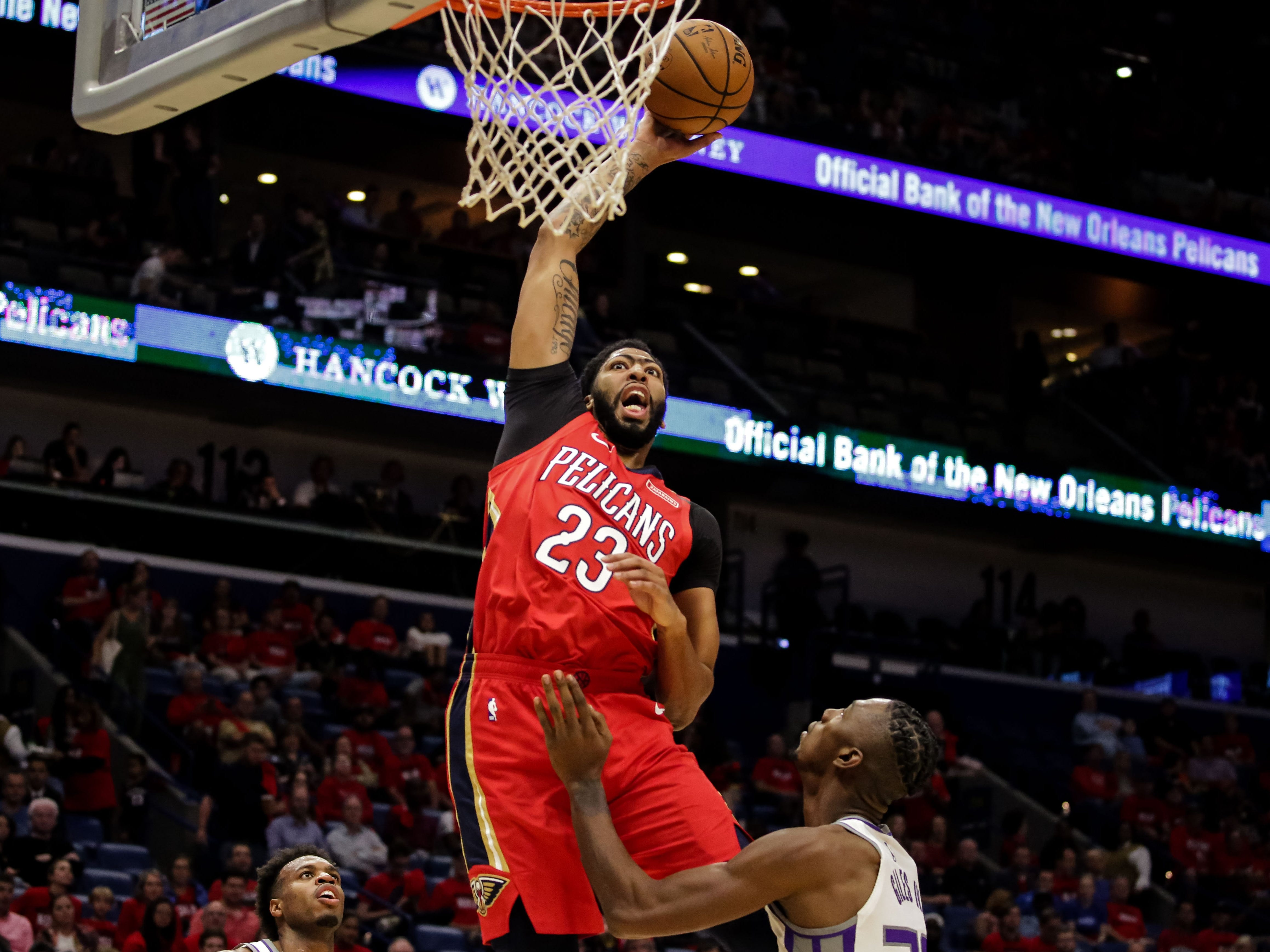 Oct. 19: Pelicans forward Anthony Davis goes up high for a monster one-handed flush against the Kings.