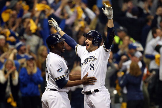 Lorenzo Cain and Ryan Braun celebrate after scoring in the first inning.