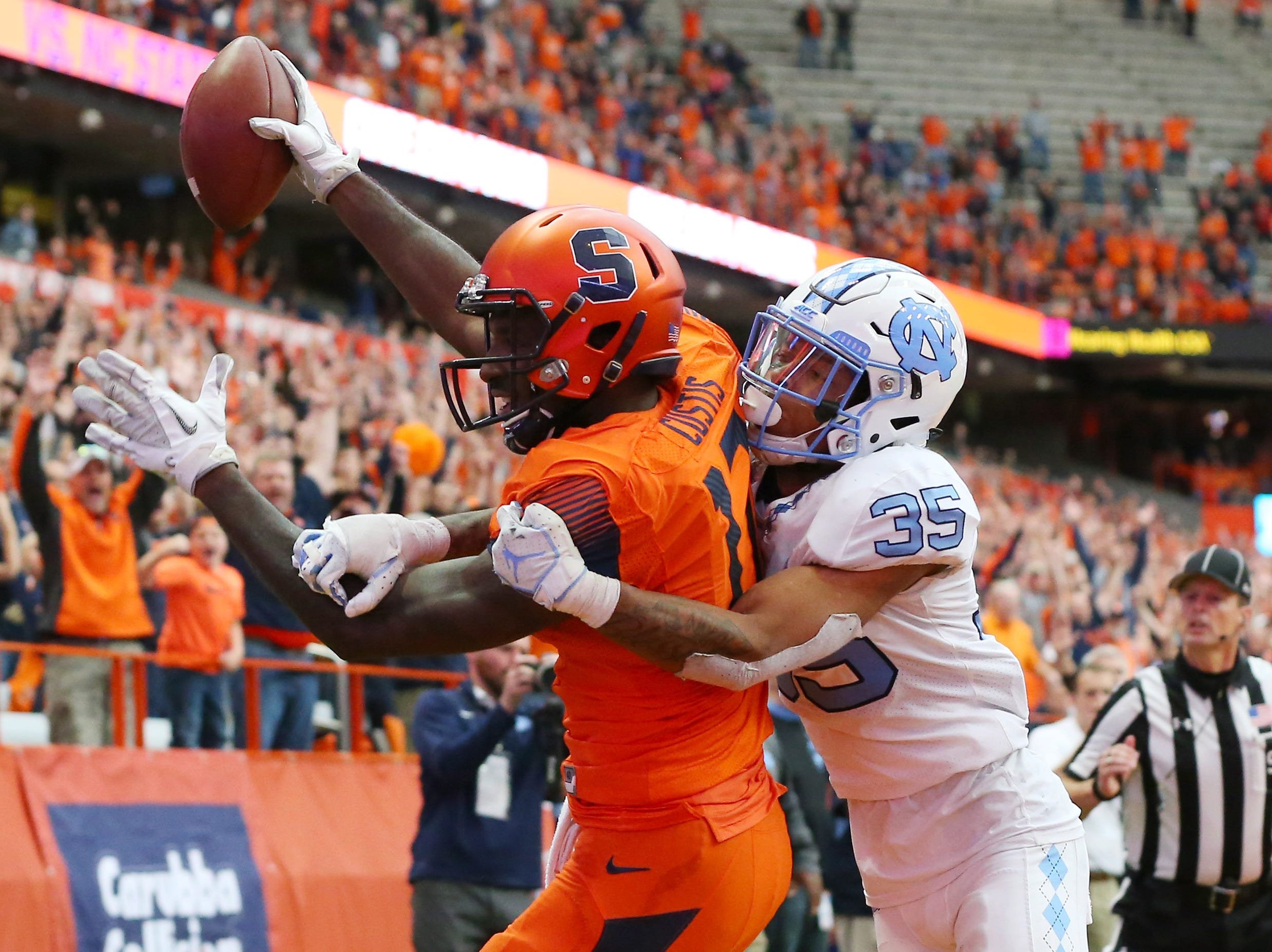 Syracuse Orange wide receiver Jamal Custis (17) catches a pass for a touchdown in overtime as North Carolina Tar Heels cornerback Greg Ross (35) defends at the Carrier Dome.
