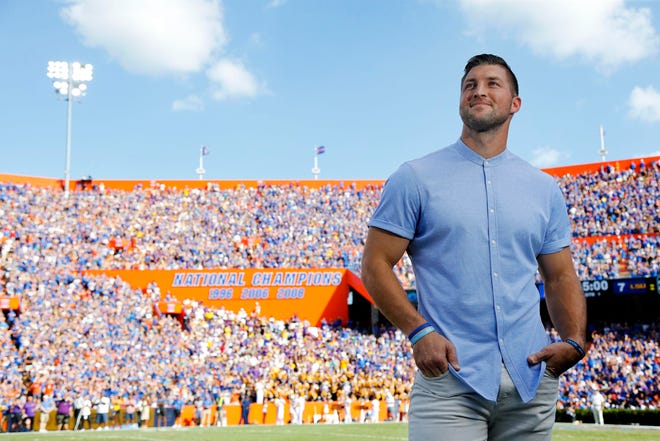 Former Florida quarterback Tim Tebow is inducted into the Ring of Honor at the end of the first quarter against LSU at Ben Hill Griffin Stadium.
