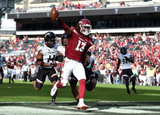 Temple Owls wide receiver Isaiah Wright (13) celebrates in the end zone after scoring a touchdown past Cincinnati Bearcats cornerback Cameron Jefferies (14) and safety Darrick Forrest (5) during overtime at Lincoln Financial Field.