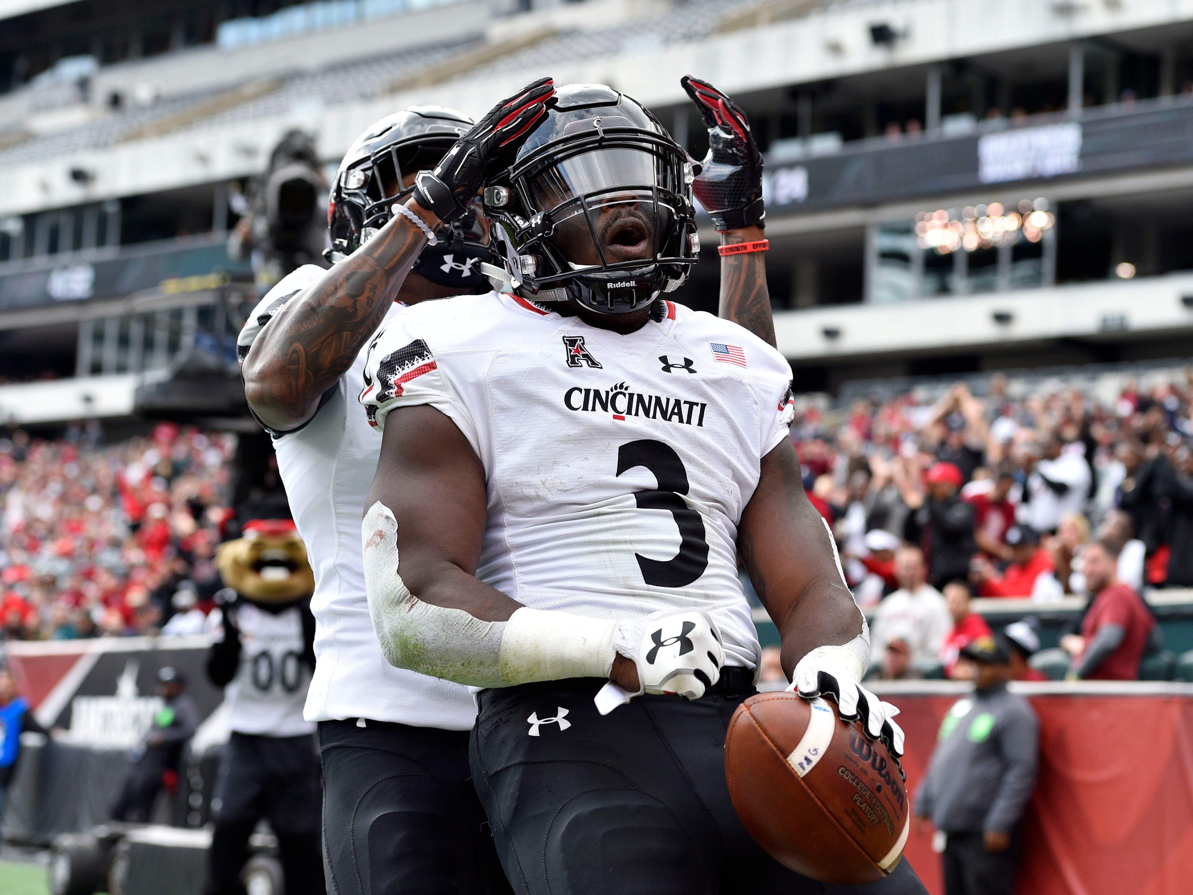 Cincinnati Bearcats running back Michael Warren II (3) celebrates with wide receiver Kahlil Lewis (1) after a first-quarter touchdown against  Temple at Lincoln Financial Field. 20181020_ajw_hb3_015.jpg