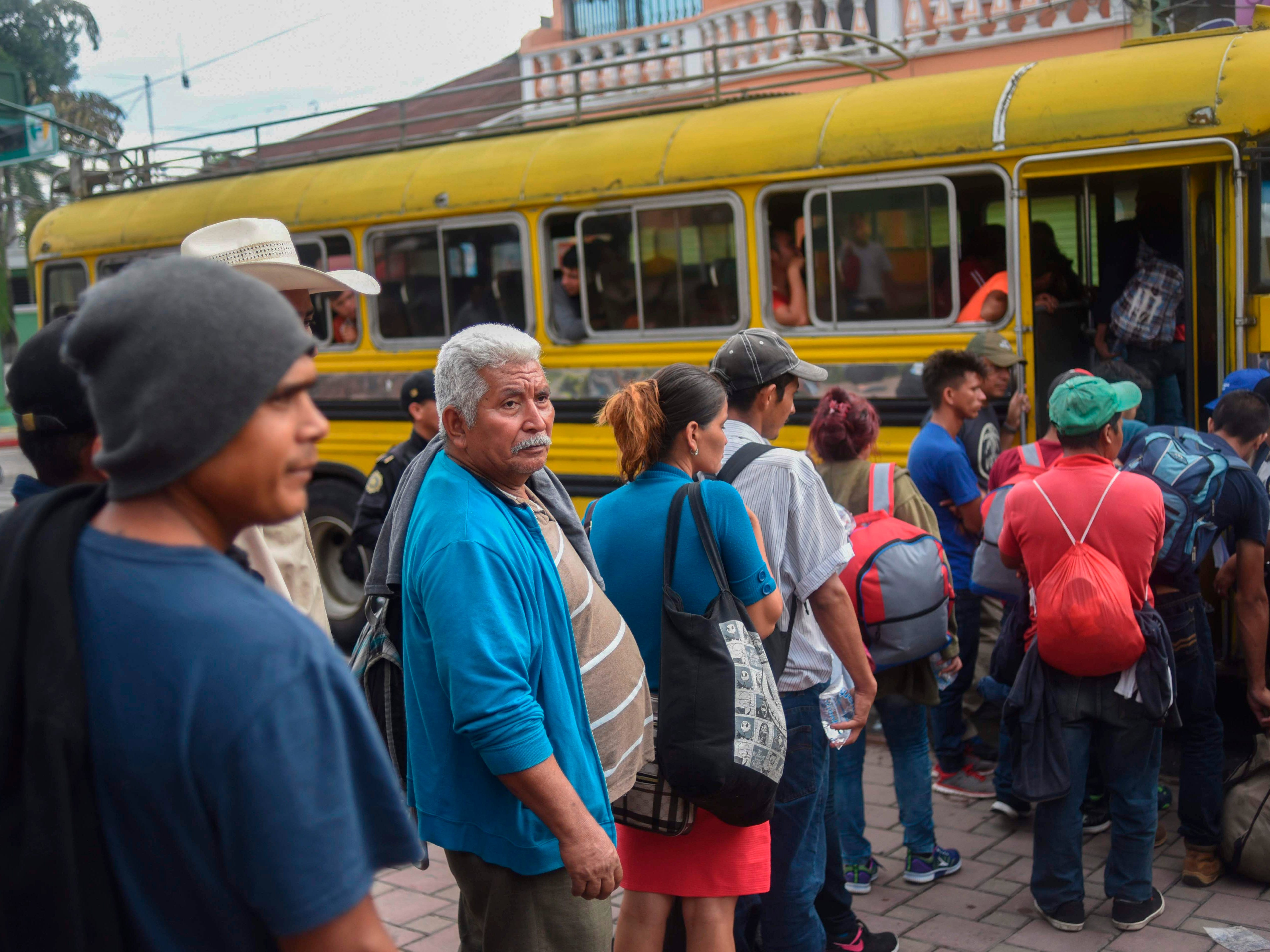 Honduran migrants, who were taking part in a caravan heading to the US, board a bus to return to Honduras, in Ciudad Tecun Uman, Guatemala, on Oct. 20, 2018. Some 220 Honduran migrants were returning to their country and some 130 were waiting at a shelter Saturday, according to a police source, while thousands who forced their way through Guatemala's northwestern border and flooded onto a bridge leading to Mexico, were waiting at the border in the hope of continuing their journey.