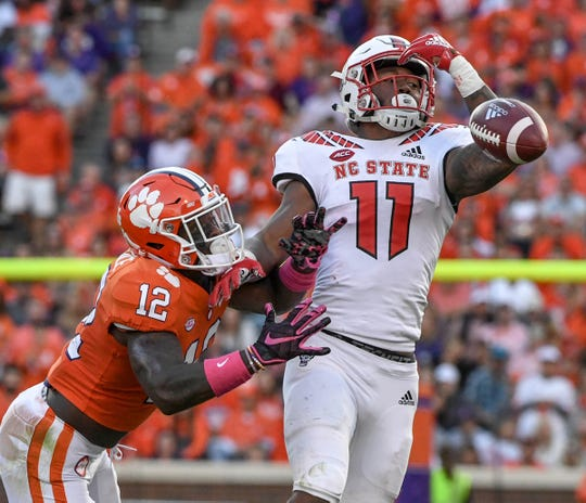 NC State wide receiver Jakobi Meyers (11) nearly catches ball near Clemson defensive back K'Von Wallace (12) during the first quarter in Memorial Stadium on Saturday, October 20, 2018.