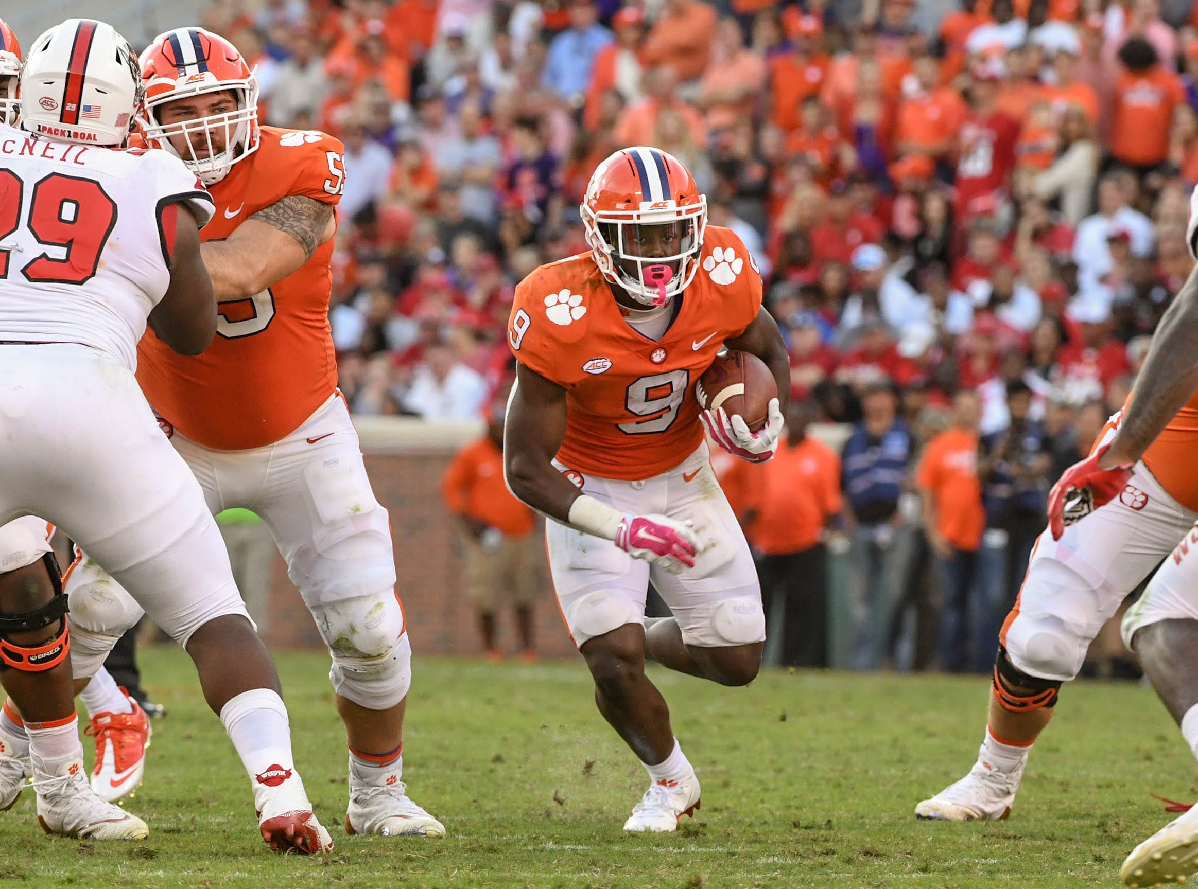 Clemson running back Travis Etienne (9) runs end a series with NC State during the first quarter in Memorial Stadium on Saturday, October 20, 2018.