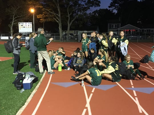 Red Bank Catholic coach Frank Lawrence talks to the team after its 1-0 Shore Conference Tournament Semifinal win over Freehold Township on Oct. 20, 2018 at Point Pleasant Borough High School.