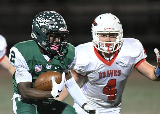 Long Branch running back Jermaine Corbett (No. 2), who ran for 321 yards and two touchdowns in the Green Wave's 34-0 win over Manalapan, is one of the nominees for the Asbury Park Press Football Player of the Week