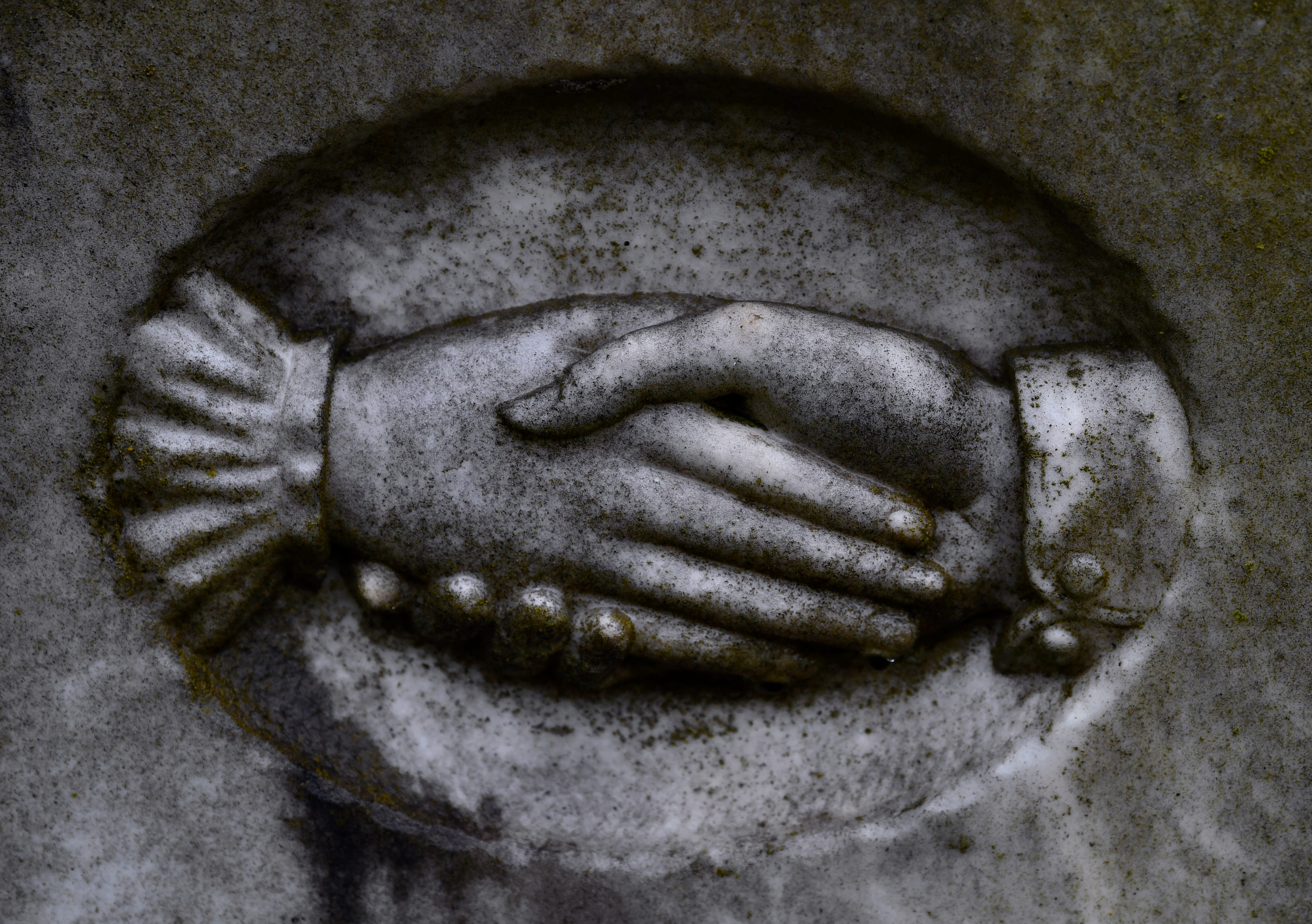 A detail of clasped hands found on the grave marker of Axel Bernhard Eriksson, 19, who died May 24, 1892. Greenleaf Cemetery in Brownwood turned 150 years old this year.