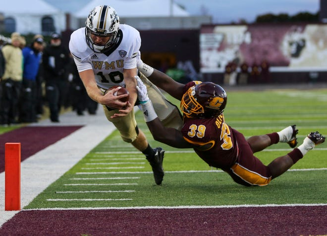 Western Michigan Broncos quarterback Jon Wassink (16) dives to score a touchdown against Central Michigan in Mount Pleasant, Mich., Saturday, Oct. 20, 2018.