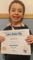 Matty Brunick, Norwich, was presented with an award for being a Bucket Filler.