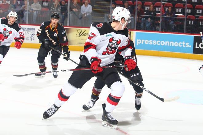 The Binghamton Devils' john Quenneville battles for position Saturday night at the Floyd L. Maines Veterans Memorial Arena.