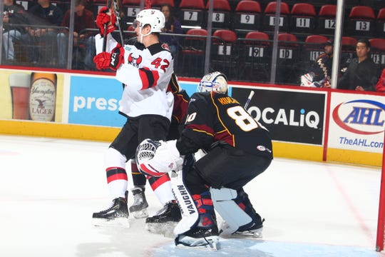The Binghamton Devils' Nathan Bastian runs interference in front of Cleveland's goal during Saturday's game at Floyd L. Maines Veterans Memorial Arena.