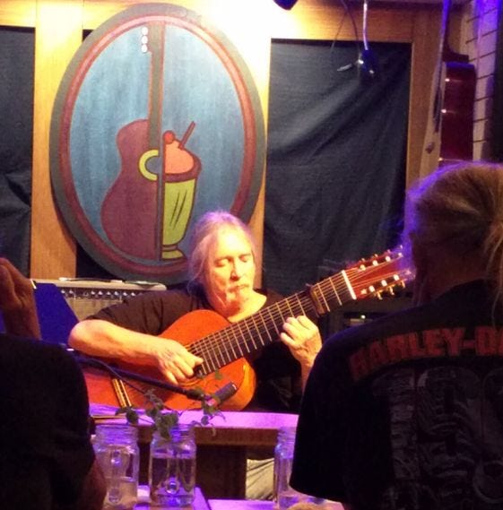 Craig Alden Dell plays during one of his monthly Saturday-evening appearances at the Guitar Cafe in Silverdale.